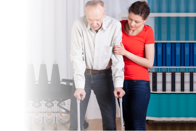 caregiver helping patient in walking