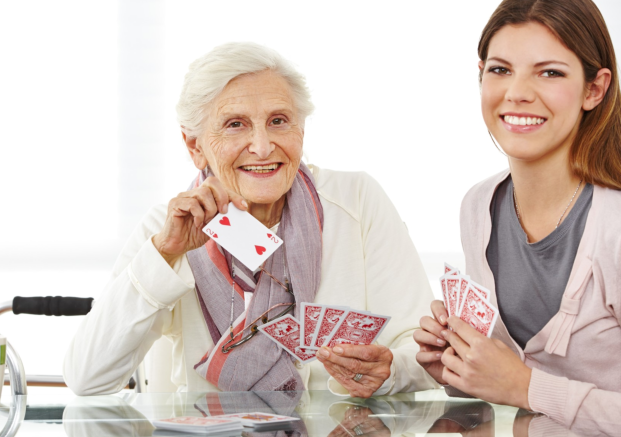 caregiver and patient playing card games