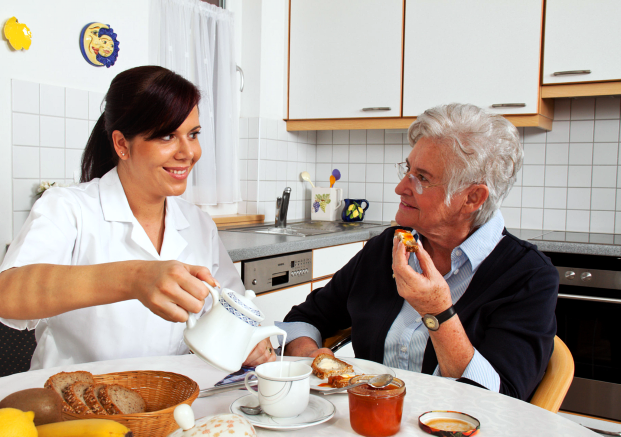 caregiver helping patient in eating